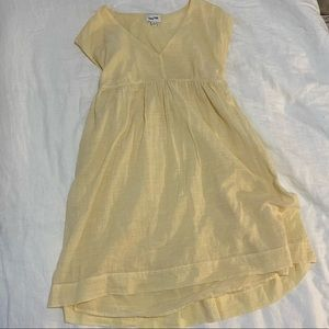 Babydoll, oversized, pale yellow and white dress.